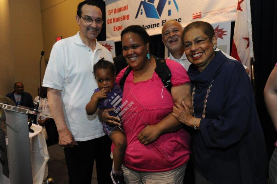 House Lottery winner Christina Brown with Mayor Gray and Congresswoman Holmes Norton